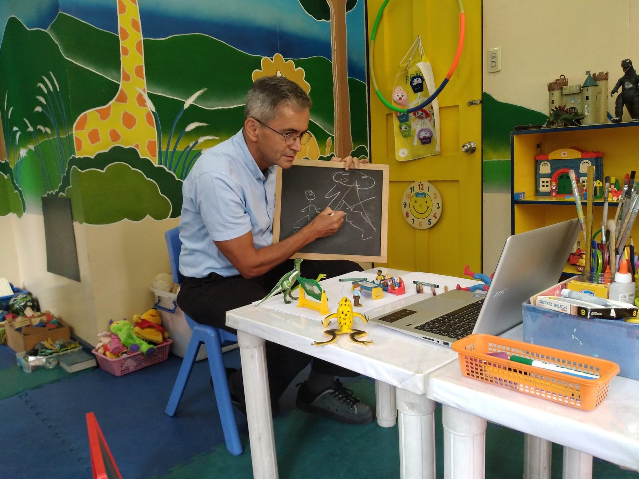 Fr. Geraldo teaching play therapy