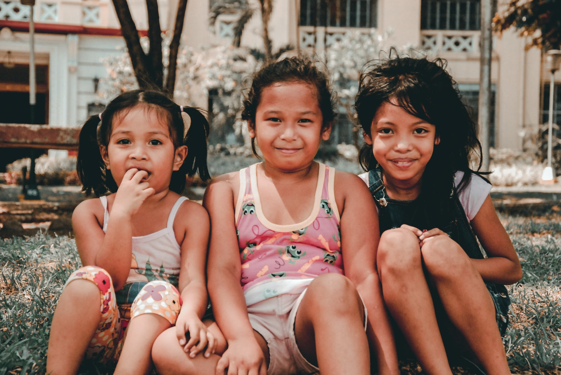 3 Children sitting in the Philippines